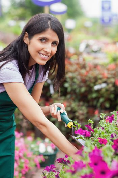 Cheerful florist spading