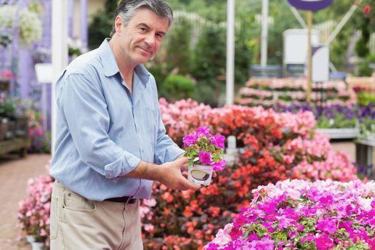 Man deciding on the pink flower