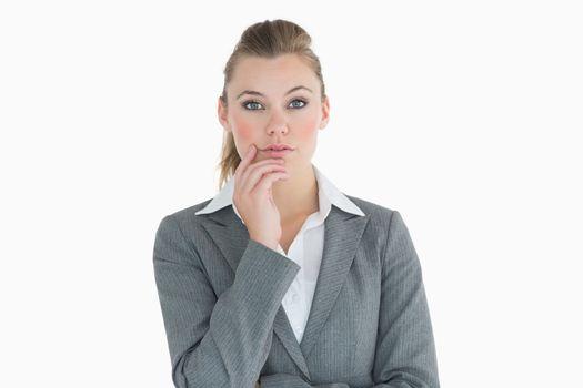 Businesswoman touching her cheek