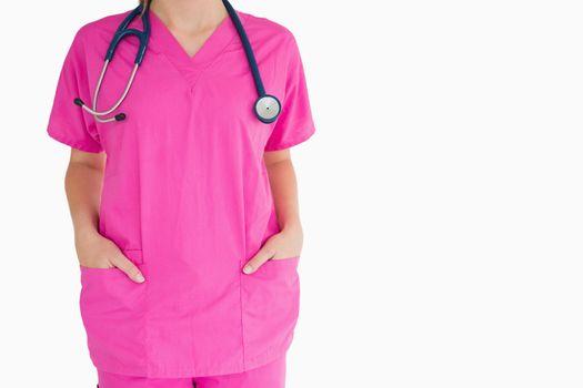 Woman in pink scrubs
