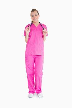 Smiling woman in pink scrubs