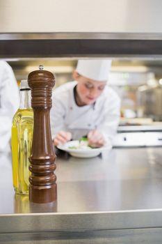 Pepper grinder and olive oil