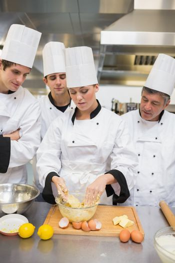 Trainees learning how to prepare dough