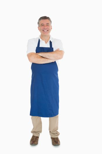Laughing man dressed in apron