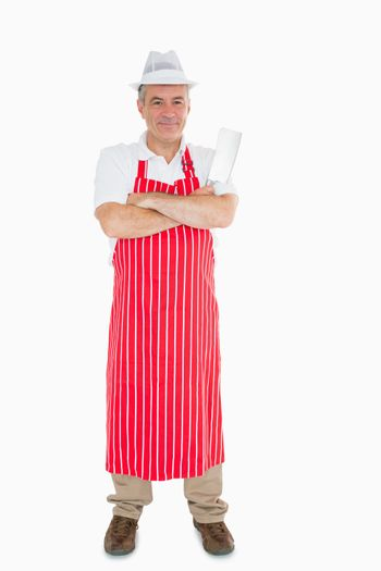 Butcher in apron with meat cleaver