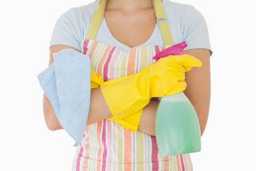 Woman holding window cleaner and rag