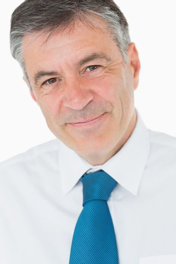 Smiling businessman with grey hair