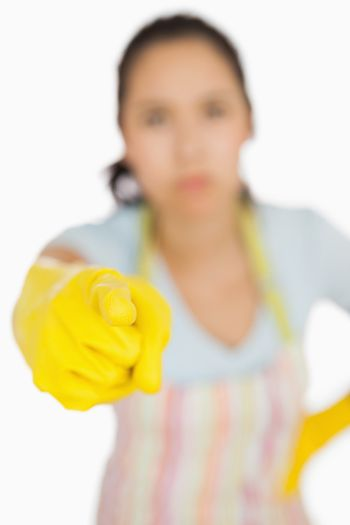 Woman in apron pointing accusingly
