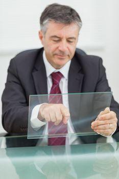 Business man scrolling on a virtual screen