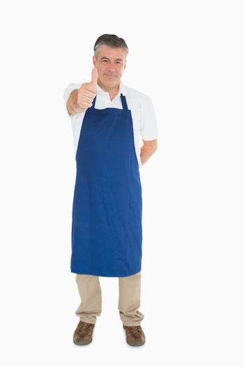 Man in apron giving thumbs up