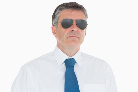 Stern businessman in sunglasses