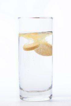 Vitamin tablet dissolving in water