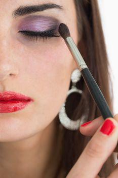 Woman applying smoky eyes