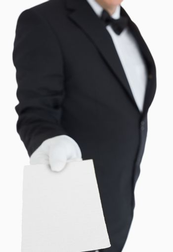 Waiter passing out a card