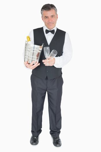 Waiter holding glasses and champagne cooler