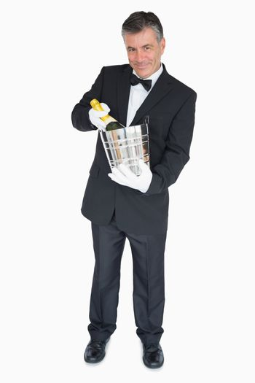 Waiter offering bottle of champagne in cooler