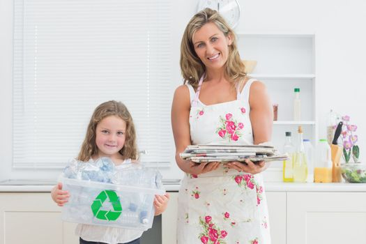 Mother and daughter holding waste