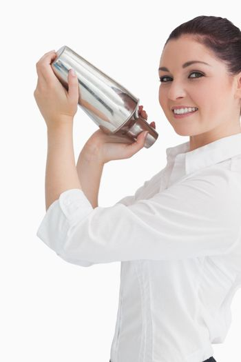 Woman using cocktail shaker