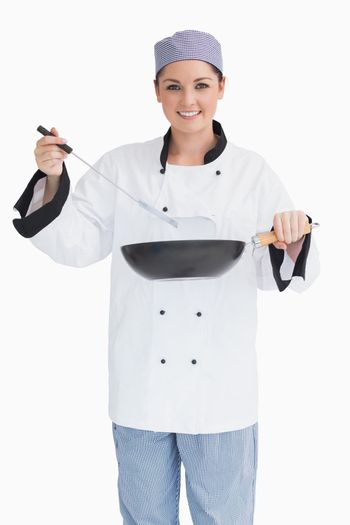 Glad cook cooking with wok and spoon