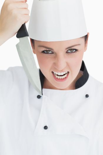 Furious cook holding a knife