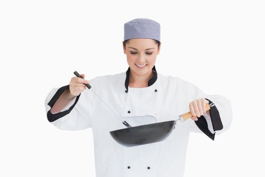 Cook cooking with wok and spoon