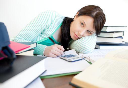 Annoyed teen girl studying
