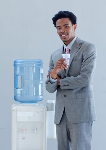 Businessman with a water cooler in office