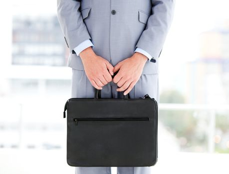 Mysterious businessman holding a briefcase