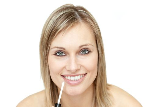 Delighted woman putting gloss