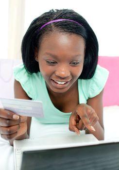 Cheerful teen girl shopping on-line