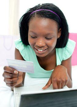 Smiling teen girl shopping on-line