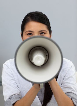 Confident ethnic businesswoman yelling instructions