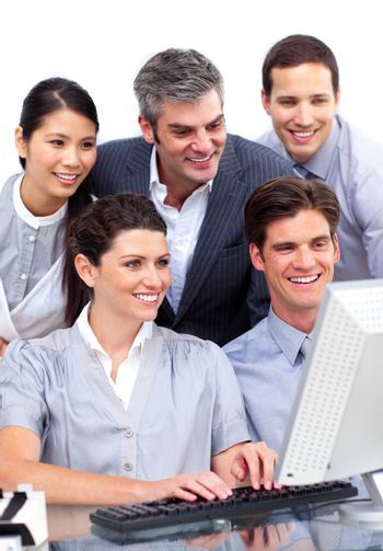 Competitive business group working at a computer