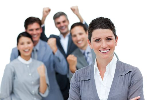 Cheerful business partners punching the air in celebration against a white background