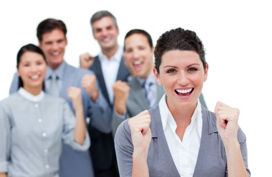 Happy business partners punching the air in celebration against a white background