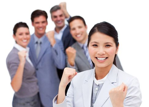 Multi-ethnic business team punching the air in celebration against a white background
