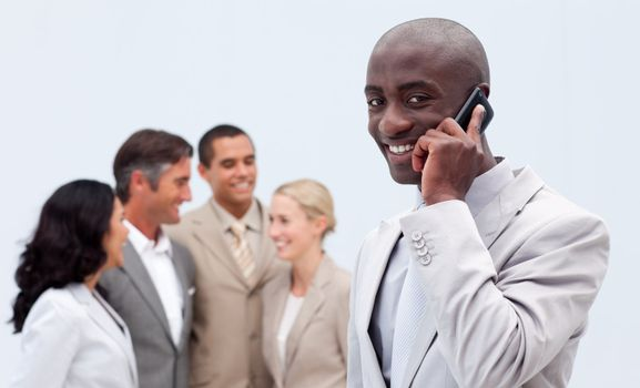 Afro-American businessman on phone at workplace