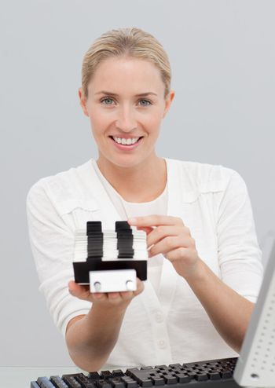 Businesswoman holding an index holder