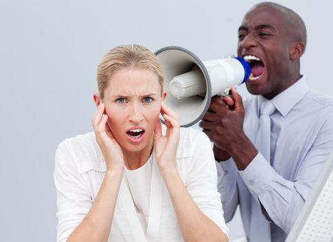 Furious businessman shouting through a megaphone