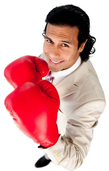 Competitive businessman wearing boxing gloves
