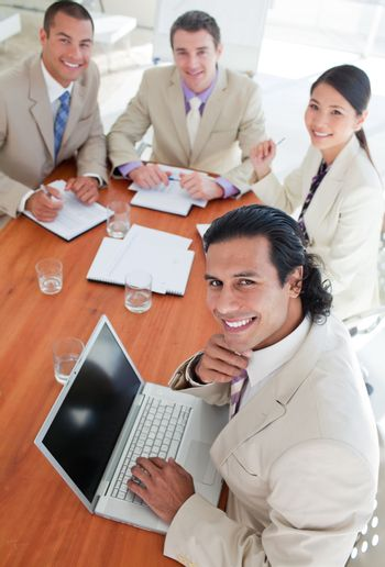 Confident business co-workers in a meeting
