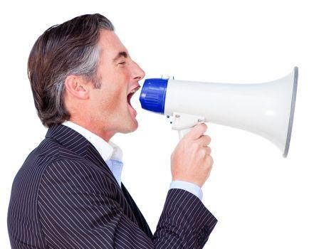 Businessman shouting instructions through a megaphone