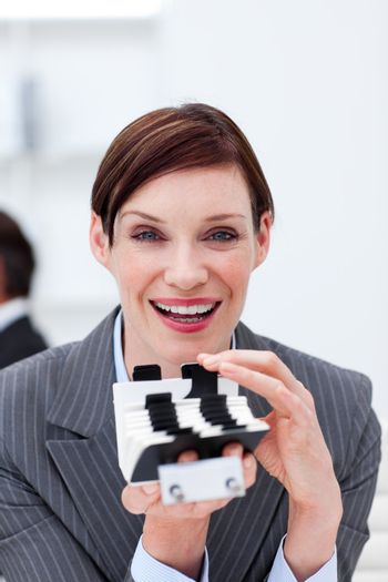 Smiling businesswoman holding a card holder
