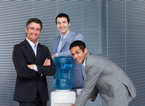 Multi-ethnic business team at water cooler