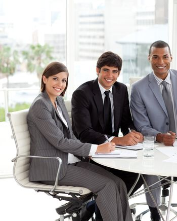 Three co-workers smiling at the camera