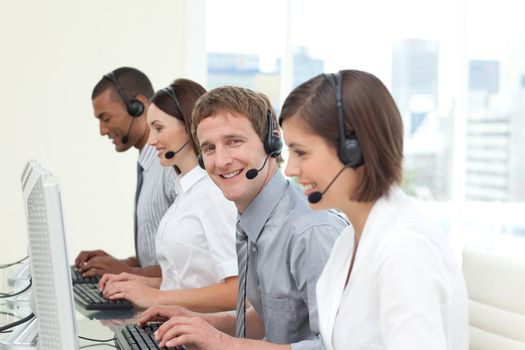 Young co-workers with headset on