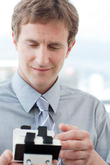 Businessman consulting a business card holder