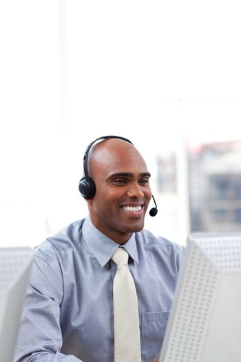 Ethnic businessman with headset on