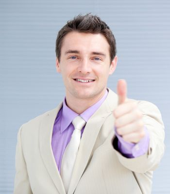 Positive businessman with a thumb up