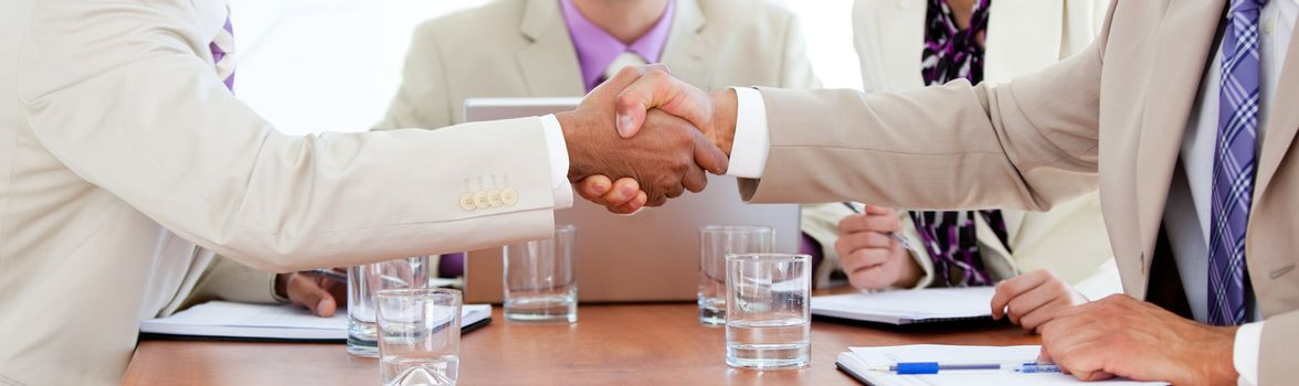 Two business people closing a deal
